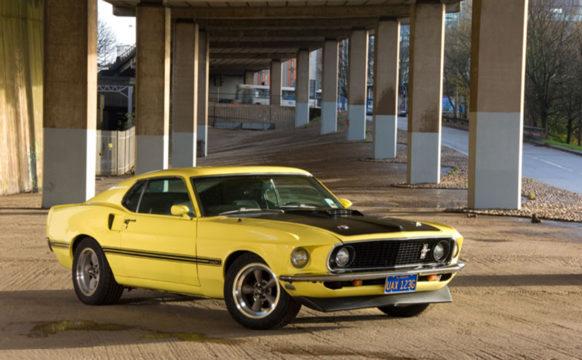 10_47-Star-Car-HireYellow-Ford-Mustang-sunshine-angle-shot.jpg
